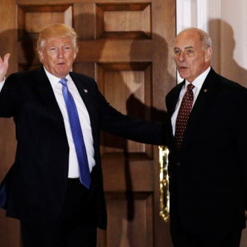 Image: U.S. President-elect Donald Trump appears with retired Marine Corps General John Kelly outside the main clubhouse after their meeting at Trump National Golf Club in Bedminster