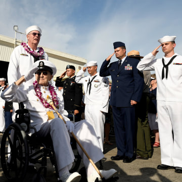 Image: Pearl Harbor survivor Robert Coles salutes active U.S. service members after the ceremonies honoring the 75th anniversary of the attack on Pearl Harbor at Kilo Pier on Joint Base Pearl Harbor - Hickam in Honolulu