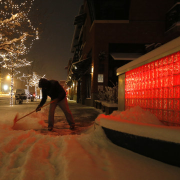 Image: Rick Velasquez shovels fresh snow during a winter storm in Boulder