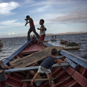 """Image: Children play """"pirates"""" on a fishing boat"""