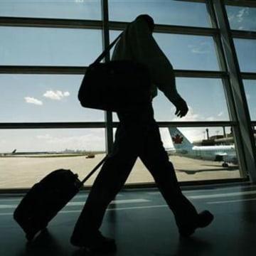 An Air Canada passenger walks to catch his plane
