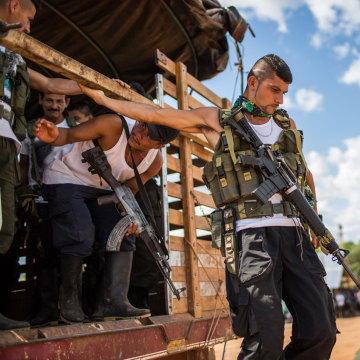 Image: FARC rebels from nearby camps arrive for the meeting
