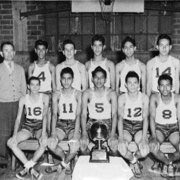 The Lanier High School Voks basketball team with their 1939 San Antonio Championship trophy.
