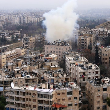Image: Smoke rises from the al-Ethaa government-held neighborhood in eastern Aleppo during clashes on Dec. 5.