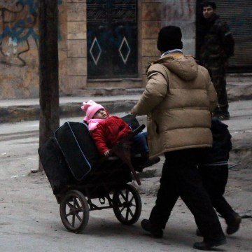 Image: Civilians flee the Sukkari neighborhood towards safer areas in southeastern Aleppo, Monday.