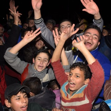 Image: Civilians celebrate in the government-held Mogambo neighborhood of Aleppo after pro-Assad forces won more territory in the city.