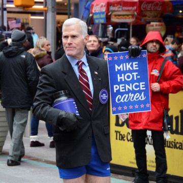 "Image: Glenn Pannell, known as ""Mike Hot-Pence"", a look-alike for Vice President-elect Mike Pence, takes a collection LGBTQ rights causes in New York City on Dec. 3, 2016."