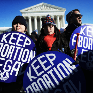 Image: Pro-choice activists hold signs in front of the U.S. Supreme Court on Jan. 22, 2014 on Capitol Hill in Washington, D.C.