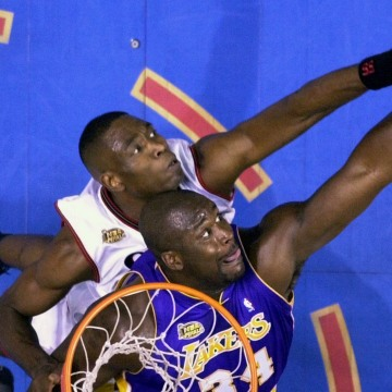 Image: Philadelphia 76ers' Dikembe Mutombo, top, and Los Angeles Lakers' Shaquille O'Neal