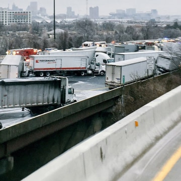 Image: Trucks and vehicles are shown in a pile-up involving a fuel tanker which skidded off the an icey 1-95 highway in Baltimore