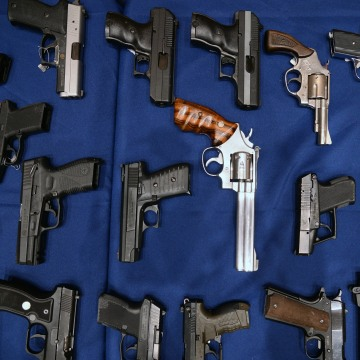 Image: A collection of seized weapons seen on display during a press conference