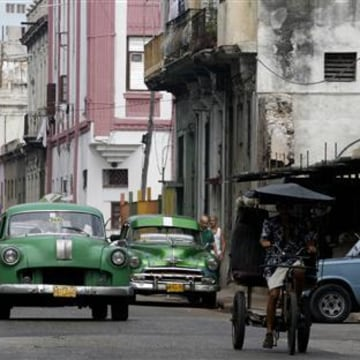 Cars drive on a street in Havana