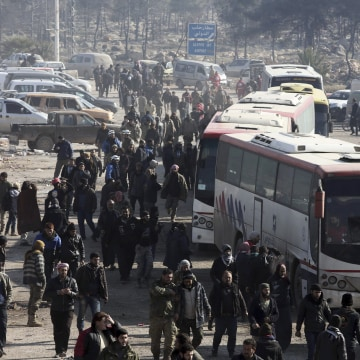 Image: Syrians evacuated from the embattled Syrian city of Aleppo