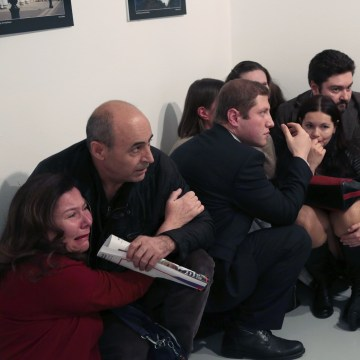 Image: People crouch in corner after Andrei Karlov killing