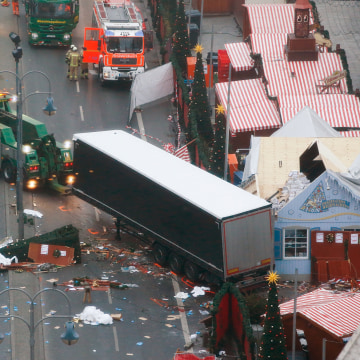 Image: Rescue workers tow the truck which ploughed into a crowded Christmas market in the German capital last night in Berlin