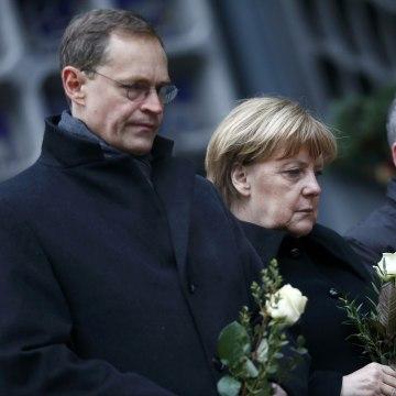 Image: Berlin Mayor Michael Mueller, German Chancellor Angela Merkel and German Interior Minister Thomas de Maiziere