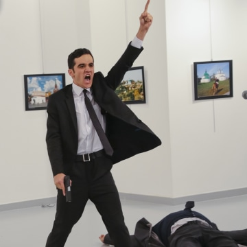 Image: An unnamed gunman gestures after shooting the Russian Ambassador to Turkey, Andrei Karlov, at a photo gallery in Ankara, Turkey, Dec. 19, 2016.