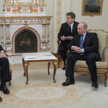 Image: Russian Prime Minister Vladimir Putin, right, listens to Rex W. Tillerson, chairman and chief executive officer of Exxon Mobil Corporation at their meeting outside Moscow, April 16, 2012.