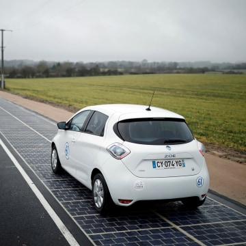Image: An automobile drives on a solar panel road during its inauguration in Tourouvre
