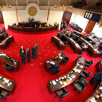 Image: Lawmakers confer during a negotiations on the floor of North Carolina's State Senate chamber as they meet to consider repealing the controversial HB2 law limiting bathroom access for transgender people in Raleigh, North Carolina