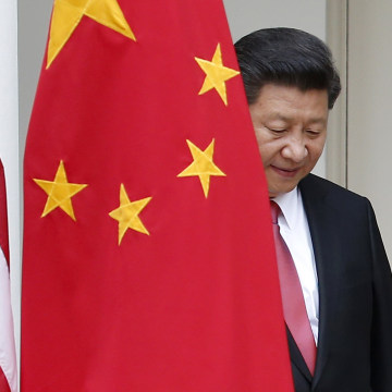 Image: Chinese President Xi Jinping steps out from behind China's flag