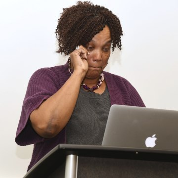 Image: Kathryn Stanley tears up while speaking at Robert Franklin's class on faith and politics at Emory University