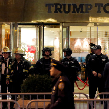 Image: Police and fire crew stand outside Trump Tower following a report of a suspicious package in Manhattan, New York City