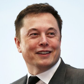 Image: Tesla Chief Executive Elon Musk smiles as he attends a forum on startups in Hong Kong