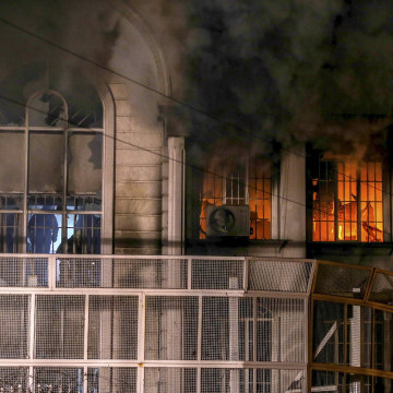 Image: Flames and smoke rise from Saudi Arabia's embassy during a demonstration at in Tehran