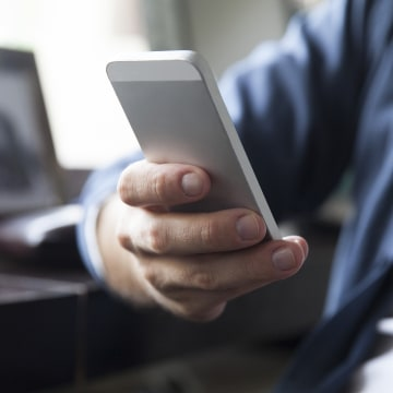 Image: Man checking email on cell phone