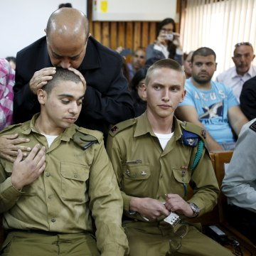 Image: The father of Elor Azaria kisses his head during an earlier hearing.
