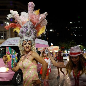 Image: Parade goers celebrate during the Sydney Gay & Lesbian Mardi Gras Parade