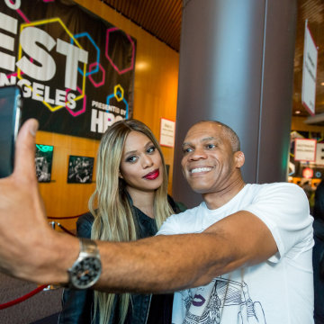 Image: Actress Laverne Cox (L) takes a photo with a guest