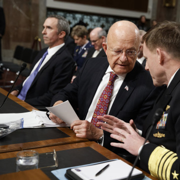 Image: Director of National Intelligence James Clapper, center, talks with National Security Agency and Cyber Command chief Adm. Michael Rogers