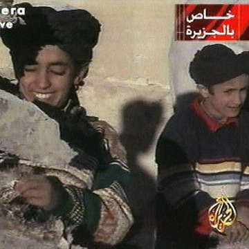 Image: In this image made from video broadcast by the Qatari-based satellite television station Al-Jazeera on Nov. 7, 2001, a young boy, left, identified as Hamza bin Laden is pictured on Nov. 5, 2001.