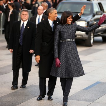 Image: President Barack Obama and First lady Michelle Obama walk the route as the presidential inaugural parade winds through the nation's capital on Jan. 21, 2013 in Washington, D.C.
