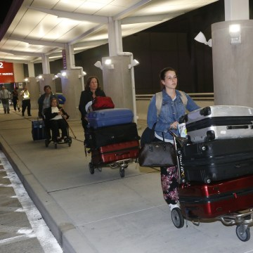 Image: Passengers are eventually allowed to leave Fort Lauderdale-Hollywood International Airport.