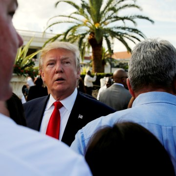 Image: Donald Trump listens to questions from reporters after a campaign event with his employees at his Trump National Doral golf club in Miami, Florida, Oct. 25, 2016.