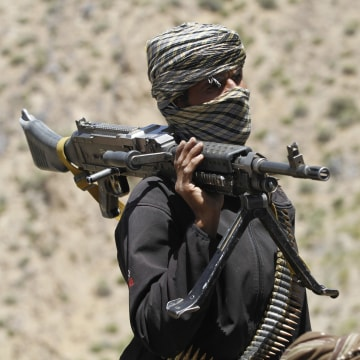 Image: Image: A member of a Taliban faction