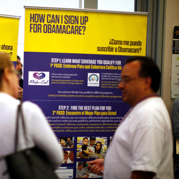 Image: FILE PHOTO -  Julian Gomez explains Obamacare to people at a health insurance enrolment event in Commerce