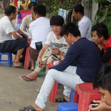 Image: Men at a roadside tea stall in Yangon