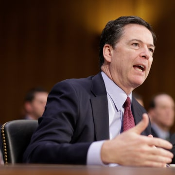 """Image: FBI Director James Comey testifies to the Senate Select Committee on Intelligence hearing on ?EURoeRussia?EUR(TM)s intelligence activities"""" on Capitol Hill in Washington"""