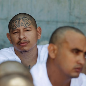 Mara Salvatrucha (MS-13) gang members wait to be escorted upon their arrival at the maximum security jail in Zacatecoluca