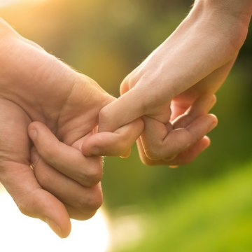 Image: A couple holds hands.