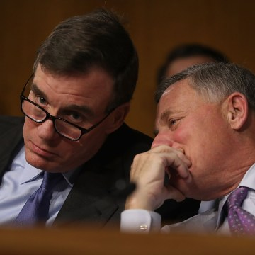 Image: Sen. Mark R. Warner, Vice Chair of the Senate Select Committee on Intelligence, and Sen. Richard Burr, Chairman of the Senate Select Committee on Intelligence, speak together during the Senate Intelligence Committee on Capitol Hill on Jan. 10 in Wa