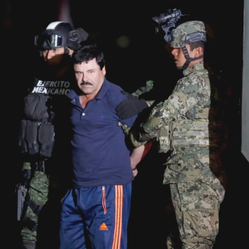 """Image: Joaquin """"El Chapo"""" Guzman is escorted by soldiers during a presentation in Mexico City, Jan. 8, 2016."""