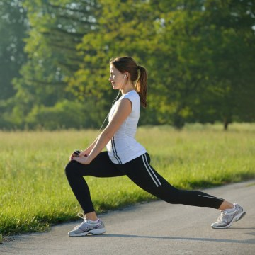 Image:  young woman stretching before Fitness and Exercise