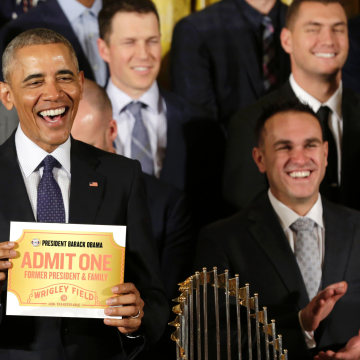 Image: Obama holds a lifetime admission certificate