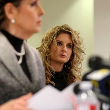 Image: Summer Zervos listens as her attorney Gloria Allred speaks during a news conference announcing the filing of a lawsuit against President-elect Donald Trump in Los Angeles, Calif., on Jan. 17, 2017.