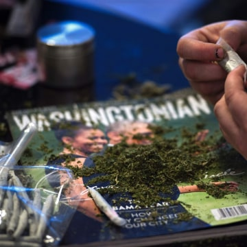 Image: Members of the DC Marijuana Coalition that plan on handing out approx 4,200 joints of legally grown cannabis on Jan. 20 roll joints on Jan. 5 inside their home in Washington, D.C.